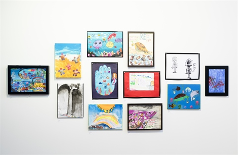 Children's artwork displayed on the wall