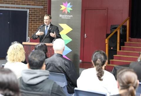 Blacktown City Mayor Stephen Bali MP addresses the Rooty Hill community forum. .JPG