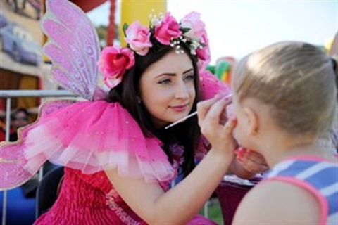 Fairy doing face painting