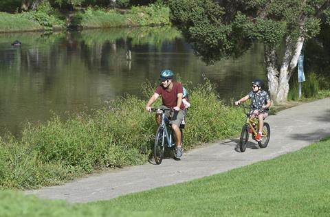 Family cycling next to Blacktown Creek